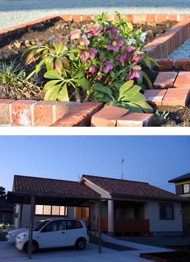 花壇と夕暮時の外観